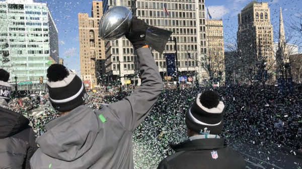 Foles holds the trophy aloft approaching LOVE Park