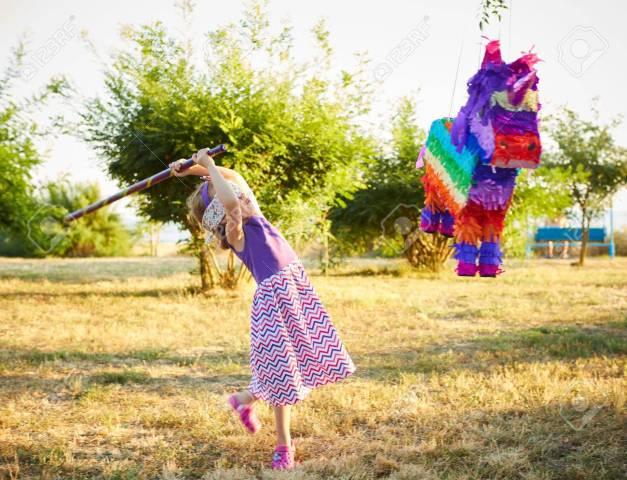 hitting-a-pinata-celebrating-a-birthday-.jpg