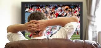 guy watching football.jpeg