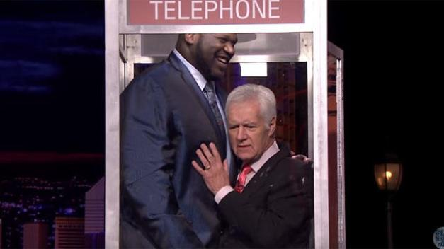 Shaq and Alex Trebek in a phone booth.jpg