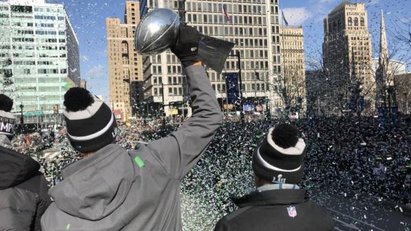 Foles holds the trophy aloft approaching LOVE Park