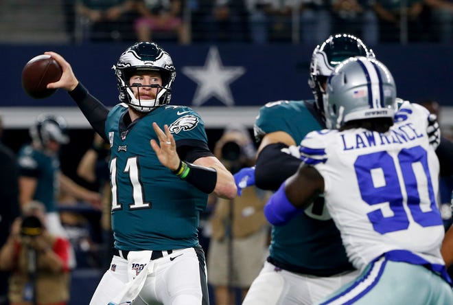 lane jonson stonewalls demarcus lawrence as carson wentz sets to deliver.